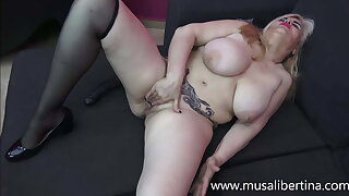 Sexy and glamorous mature masturbates with her black dildo