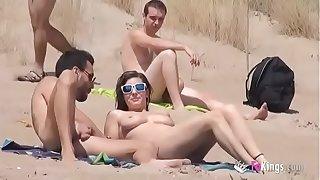Sol fucks a suppliant almost a seaside midst voyeurs