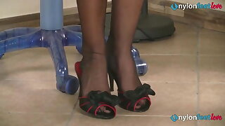 Redhead secretaries feet shoeplay in stockings coupled with pantyhose